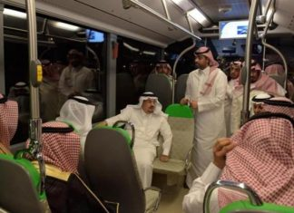 Riyadh Emir Prince Faisal Bin Bandar inspects the new coaches for the bus network project on Monday. (SPA)